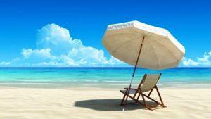 Ležalnik s sončnikom na plaži