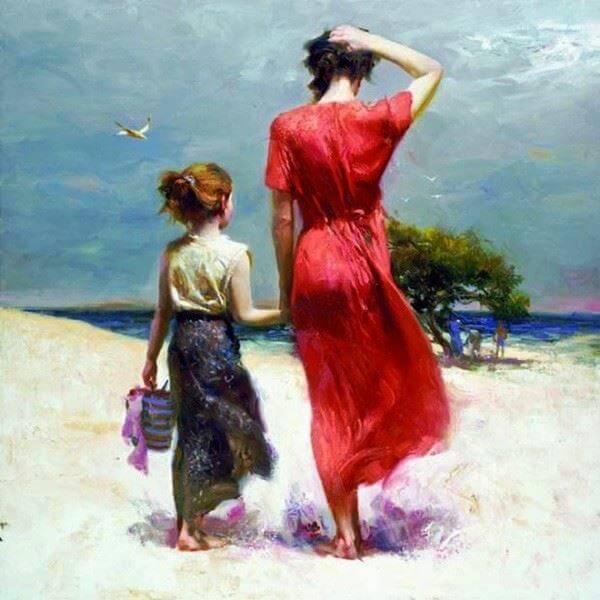 Ženska in hči na plaži